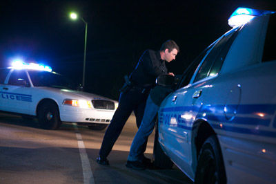 Cops searching a car - Law Offices of Hope C. Lefeber