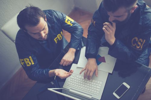 FBI and CSI agents - Federal criminal investigation concept