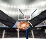 business handshake at basketball court - recruiting fraud concept